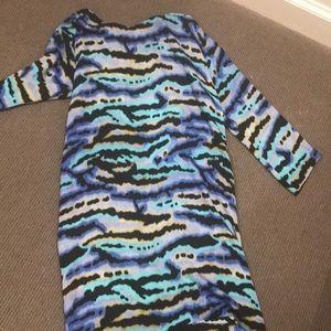 Tucker dress. 100 percent silk